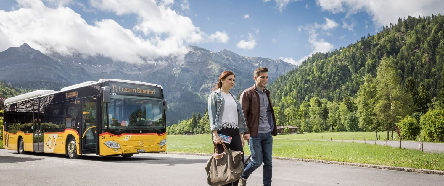 Guests in front of a PostBus